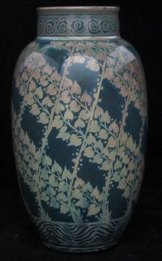 Pilkington's Lustre Vase decorated with leaves on a trellis by Charles Cundall