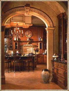 beautiful kitchen - great archway, wood color, old world
