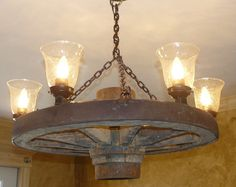 Vintage wagon wheel upcycled into chandelier