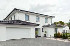 Außen klassisch-elegant, innen modern und innovativ: Dieses Einfamilienhaus hat einige clevere Überraschungen zu bieten.