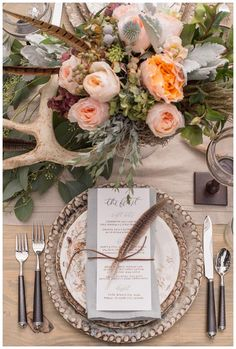 Rustic wedding reception inspiration with farm table, pheasant feathers and antler details design, styling  florals by Thorne & Thistle, paper goods by Marked, image by Heather Durham Photography.