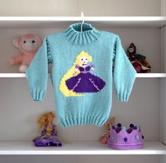 A knitting pattern for an Aran/Worsted Sweater and Crown featuring Rapunzel Pattern is for ages 2 to 10 years. Perfect for little girls who love Prin