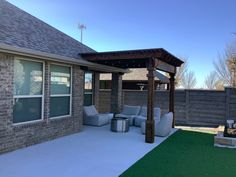 Groundscape built this pergolad , croncrete , and layed synthetic grass Patio Grill, Deck Makeover, Landscape Services, Landscape Designs, Landscaping Company, Stained Concrete, Arbors, Outdoor Living Areas, Grass