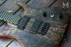 Hufschmid Guitars... like the matte black pickups against the walnut pickup rings