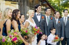 Navy dresses with gray suits on the groomsmen! ...but with coral accent in flowers and navy/coral ties