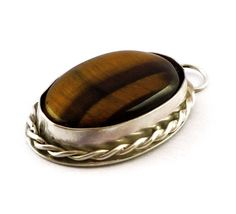 Sterling Silver Pendant with Tiger Eye stone by Hyppiechic on Etsy, $75.00
