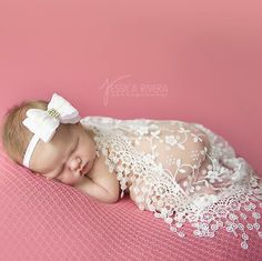 Restocked! Popular white lace fringe wrap with a pretty bow headband. Our wrap sets are currently on sale!