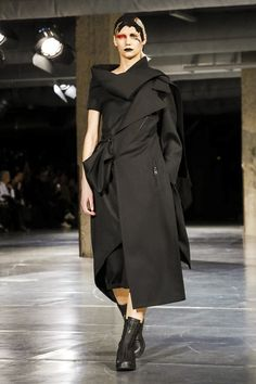 Yamamoto's shows always make for awhimsicaland memorable moment. This time around, the Japanese designer explored many darkhued fabrics andhow theyevolve when th...