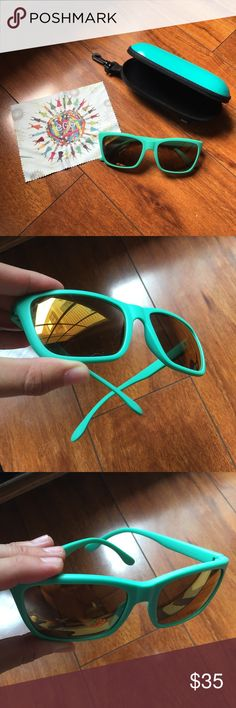 EGG Optical Turquoise Sunglasses Gently worn condition. No scratches on lenses. They have been slightly stretched out by my husband but you can mold them back gently with heat. I would say fits a bigger head better. Purchased on my vacation in Hong Kong so these are authentic. 😺🐶 Comes from a smoke-free, but not pet-free home. 🚫 No trades. No holds. 📦 Fast shipping! 🙋🏻 Considering all reasonable offers! EGG Accessories Sunglasses