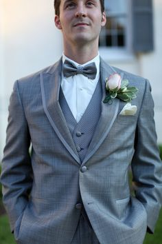 grey suit and pale pink boutonniere from Megan & Gabe's blush pink, gold, romance & champagne themed Maryland wedding. Images by Megan Beth Photography.