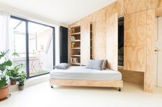 With two pieces of multifunctional furniture, this 28 square meter small apartment in Milan is able to have a living, dining, master & studio, making it feel a lot bigger than it is Small Space Living, Small Spaces, Living Spaces, Living Room, Apartment Renovation, Apartment Design, Apartment Ideas, Tiny Studio Apartments, Movable Walls