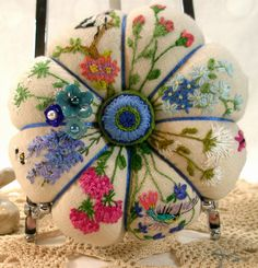 "One of my most popular pincushions is my ""Summer Garden"" . This linen pincushion is filled with beautiful embroidered flowers. Each time..."