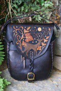 versatile rucksack / shoulder bag with hand carved stag and moon design
