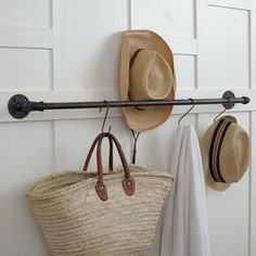 Use an industrial pipe and hooks to hold your purse and accessories in the entry way
