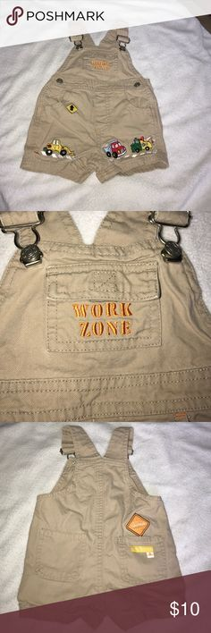 Construction Themed Short Overalls Cute khaki overalls. Pockets, buttons and snaps.  Construction details front and back Bottoms Jumpsuits & Rompers