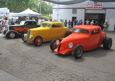 Pete Chapouris - The California Kid, Jake Jacobson's yellow coupe, and Jim Ewing's Super Bell Coupe. All '34 Ford 3-Window Coupes.