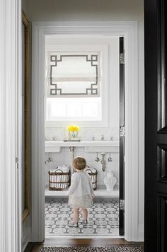 "Love everything about this space. The roman shades are fabulous. LOVING the black doors!! Perfect for the ""West Wing""."