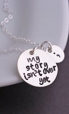 """Sterling Silver chain is available in 16, 18, 20, 24, and 30 inches. A 3/4 inch stainless steel disc is engraved with the words """"my story isn't over yet"""" and is hanging from a sterling silver chain. S"""