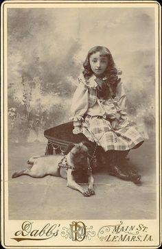 Daughter of David van Buren with her pug dog on a body leash