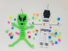 DIY bead kit with glow in the dark alien, astronaut, and specialty space beads. Pony Bead Projects, Pony Bead Crafts, Crafts With Pony Beads, Pony Bead Animals, Beaded Animals, Craft Kits For Kids, Crafts For Boys, Kid Crafts, Pony Bead Patterns