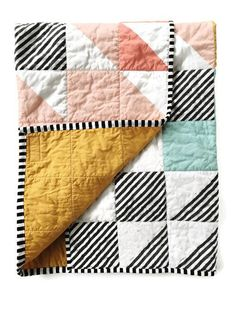 The sweetest quilt for that boho nursery! The front is a super popular print featuring squares and triangles in pink, teal, mustard, mint and black & white. The reverse is a coordinating solid mustard. Its quilted in a crosshatch pattern around the squares so they really stand out. The binding (trim) is black and white stripe. This is a perfect addition to a modern baby girls nursery. It is great for cuddling, a playmat, a nursing cover, and would be lovely decor in babys room. The finished…