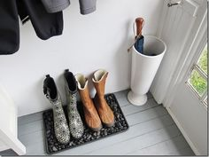 Umbrella holder is a large vase from Target! Love boots area too