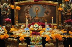 Offerings, or ofrendas — usually in the form of altars — can feature marigolds along with favorite items.