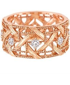 Intricate woven design gold ring with sparkles.
