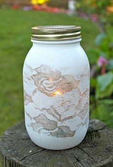 Put lace around a jar or vase before adding spray paint. Simple and so charmingly sweet!