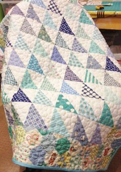 LOVE this variation of HST prints with white...a printed border all around is perfect...might add a white border first though? Baby quilt from Freda's Hive