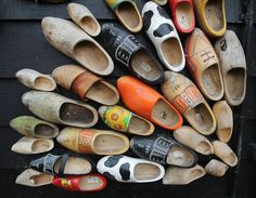 I must do this. A whole collection of wooden shoes nailed decoratively to side of house.