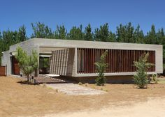 Concrete house sits among dunes on the Argentinian coastline