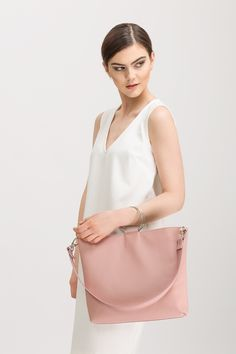 Pink leather handbag with ring handles 5e8eb816313b4