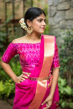 Off shoulder sari blouse, silk sari and a gold belt.