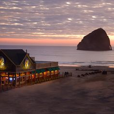 """The local pub: Pelican Brewing. Two seagulls """"guests"""" were perched atop at dawn. We saw a starfish in the sandy parking lot."""