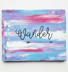 """Wander. This hand painted piece has been created on a piece of 8x10 framed canvas, so it comes to you ready to be displayed! The background features pink, blue, and white perfectly blended together. """" Wander """" and a whimsical arrow have been hand drawn in black and they really pop with the beautiful background. $20 Get this piece from our Etsy shop at www.etsy.com/shop/designsbylcw"""