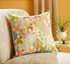 One simple block in assorted fabrics yields a knockout throw pillow | allpeoplequilt.com