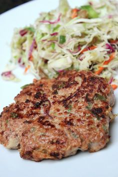 Paleo Potsticker Burgers & Asian slaw, 4 servings, 253 calories, 11.8 g fat, 26.2 g protein. SO delicious. If you microplane the ginger, only use 1 Tbsp. Makes a full and filling dinner for 2 people.