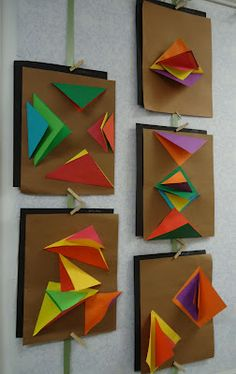 Paper folding into triangles--glue one side down on paper