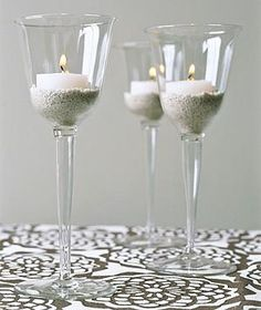 Place a votive candle in a thick-walled glass, anchored in a bed of sand or small pebbles (that makes wax cleanup a snap).