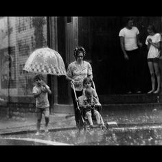 June 20, 1975: It Was Enough To Make Your Hair Cur: This family in Lower Price Hill was right where the rain was heaviest Friday evening and got soaked for it. The thunderstorms that doused the day's 94-degree heat were capricious. Some parts of Greater Cincinnati barely got wet. Less than a tenth of an inch fell at Greater Cincinnati Airport. The Enquirer/Dick Swaim