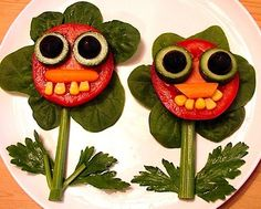 Salad Flowers: Sliced tomato face with cucumber-olive eyes, carrot nose, corn teeth & baby spinach petals atop a celery stalk stem.