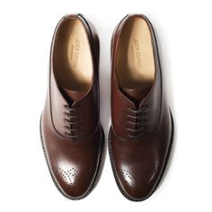 (The Not Remotely Boring) Oxfords  Designed in New York and handcrafted in Spain, these limited-edition medallion-toe oxfords are made from full-grain chocolate-brown calfskin. Plus, they cost half as much as comparable shoes, because Jack Erwin sells direct to customers. Ideal for men suffering from wing-tip fatigue