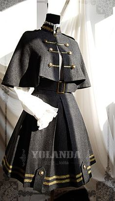 This Yolanda uniform style velvet lolita dress/outfit features the military style. The whole outfit is tailored by velvet with inside layer by polyester. This lolita outfit is for Autumn and Winter, with a big cape which is changeable. Old Fashion Dresses, Fashion Outfits, Emo Fashion, Rock Fashion, Fashion Shirts, Fashion Clothes, Fashion Ideas, Pretty Outfits, Pretty Dresses
