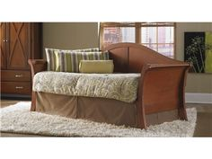Shop for Fashion Bed Group Stratford Daybed Back Mahogany OS, B50401, and other Bedroom Beds at Fiore Furniture Company in Altoona, PA. The Stratford daybed can be considered a traditional Louis Philippe sleigh style because of its camelback-shaped rear panel and curved arms, but where it departs from that classification is the widened stance of the post bottoms, which adds an Asian flair.