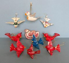 Here is a set of 10 Bird Christmas ornaments from the 1970s or 80s. There are 9 of the wood and cardboard birds and one fabric embroidered bird. During the year I buy vintage ornaments at estate sales and curate them into like groups for the holidays. These were found a many different places. Some are in better shape that others. Please check out the pictures to see missing paint. Some have bent tail feathers or a broken cord, but they are so cute you hardly notice.  There a 3 large birds…