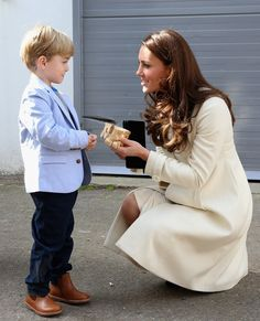 Pin for Later: It's a Girl! Celebrate the New Princess With Kate Middleton's Most Stylish Maternity Moments Kate Middleton Style The duchess was even presented with a wooden train for Prince George!
