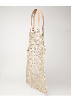 Macrame Bag by A Détacher.  Slouchy, open weave macrame bag with leather handles.  Slouchy, malleable shape / 2 leather top handles with silver rivets / Open weave / Color: Natural / 100% Vegetable Fibers / Handmade in Peru.