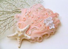 Hey, I found this really awesome Etsy listing at https://www.etsy.com/listing/218786660/peach-beach-mermaid-hair-clip-starfish