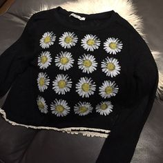 Chloe K Women's Top This is such a cute boho crop top with Daisys on the front and lace around hem. You will love this and you will look like a flower child for sure. Long sleeves and fabric is comfy 62% Rayon, Polyester and Spandex. It is in perfect never worn condition. Chloe K Tops Crop Tops